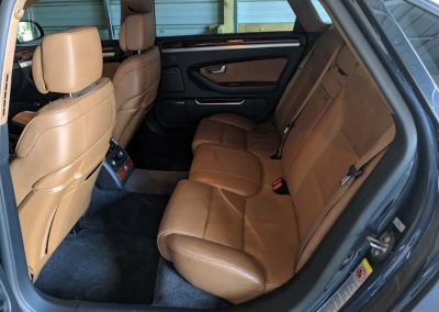 Interior of Audi backseat with brown leather.